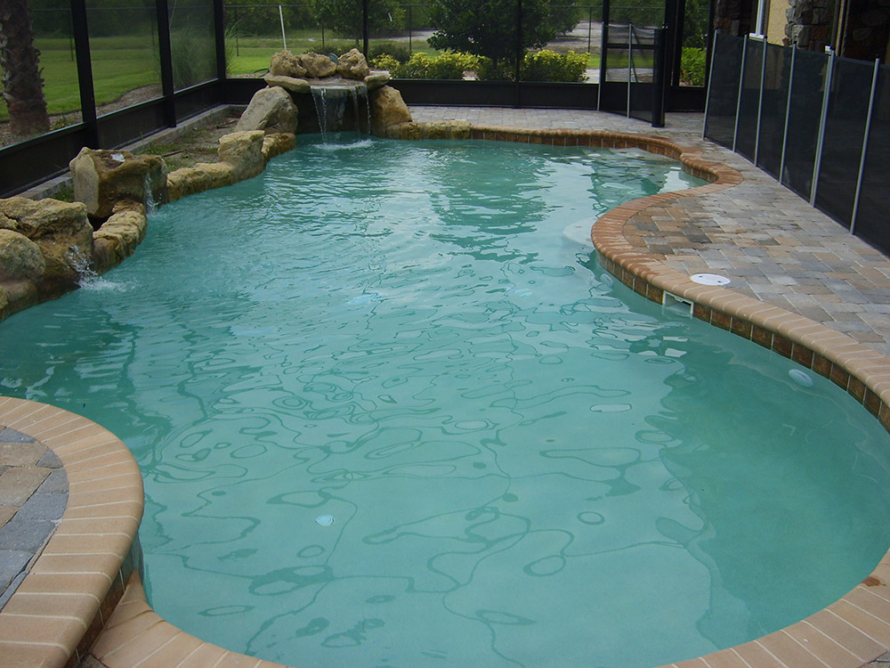 Swimming pools with rock formation design pool fountain ideas for Pool design consultant