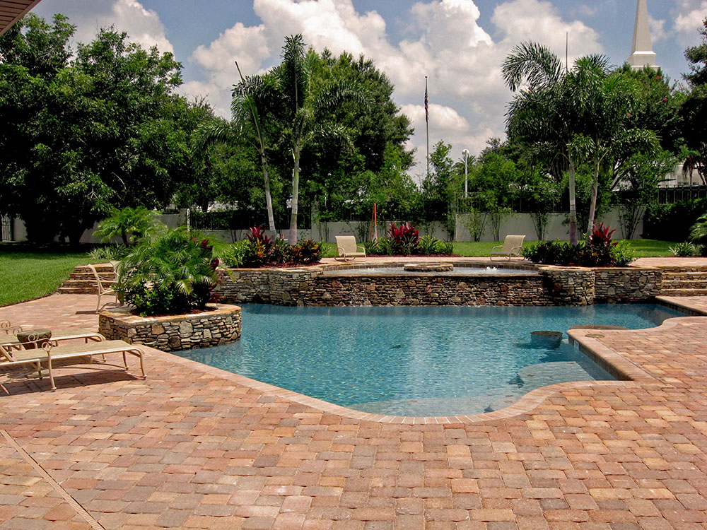 Swimming pools with rock formation design ideas for Pool design consultant