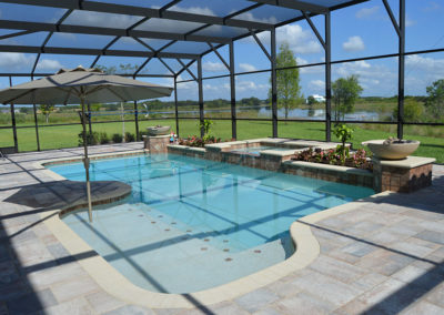pool with spa and enclosure