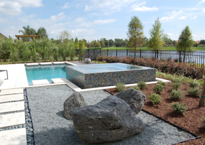 pool with tile spa and fence